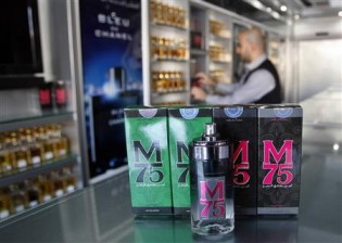 Vendor displays perfume bottles called M75 at his shop in Gaza