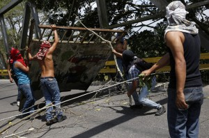 Opposition demonstrators build a barricade during a protest against President Nicolas Maduro's government in Rubio outside San Cristobal
