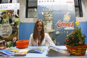 Volunteer-waits-for-visitors-at-booth-representing-Ukraine-during-opening-da-2-