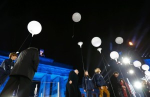 Balloons which were part of the installation 'Lichtgrenze' (Border of Light) are released in front of the Brandenburg Gate in Berlin