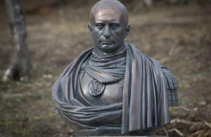 A bust of Russian president Vladimir Putin in Kasimovo village, 30 km to the north of St.Petersburg, Russia, Saturday, May 16, 2015. The bust made of some synthetic material that looked like bronze featured Putin in an image of a Roman emperor dressed in toga. The bust was opened on a private fenced territory that belongs to the Cossacks. (AP Photo/Dmitry Lovetsky)