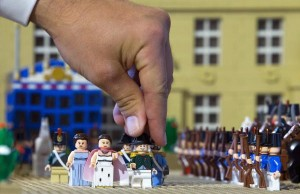 "Eric Jousse, curator of the exhibition "" Histoire en Briques Lego"" adjusts a figurine depicting Napoleon in the Malmaison Castle, made with 19,000 Lego bricks in 145 hours, in Waterloo, Belgium May 29, 2015. The exhibition, which used around one million Lego bricks, is held as part of the commemorations of the bicentenary of the Battle of Waterloo. REUTERS/Yves Herman"