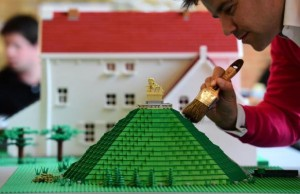 """A Lego bricks replica of La Butte du Lion (The Lion's Hill) , the main memorial monument of the Battle of Waterloo, is prepared prior to the opening of the """"History in Bricks"""" exhibition, an exhibition recreating former French emperor Napoleon I life,  in Waterloo, on May 29, 2015 as part of the celebrations marking the  200th anniversary of The Battle of Waterloo. The exhibition, created by Eric Jousse,  will run May30-July 31, 2015 in coordination with the reenactement of the battle on June 19-20, 2015, which led to the fall of Napoleon.  AFP PHOTO/Emmanuel Dunand"""
