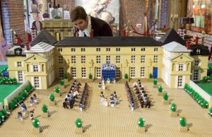 "A woman looks at a model of the Malmaison Castle, made with 19,000 Lego bricks in 145 hours as part of the exhibition ""Histoire en Briques Lego"" in Waterloo, Belgium May 29, 2015. The exhibition, which used around one million Lego bricks, is held as part of the commemorations of the bicentenary of the Battle of Waterloo. REUTERS/Yves Herman"