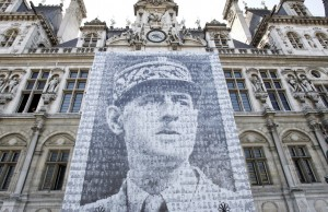 A picture taken on June 16, 2010 shows a giant banner (13x16 meters) representing France's general Charles de Gaulle on the facade of Paris townhall, as part of the commemorations for the 70th anniversary of De Gaulle stirring appeal to resist Nazism from London on June 18, 1940. The banner is a giant mosaic of 1016 portraits of Compagnons de la Liberation (French resistance members during WWII).     AFP PHOTO PATRICK KOVARIK