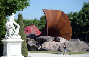"""""""Dirty Corner"""", a Cor-Ten steel, earth and mixed media monumental artwork by British contemporary artist of Indian origin Anish Kapoor, is displayed in the gardens of the Chateau de Versailles, in Versailles on June 5, 2015, as part of """"Kapoor Versailles"""", an exhibition of Kapoor's work that runs through June 9-November 1, 2015. AFP PHOTO / STEPHANE DE SAKUTIN --RESTRICTED TO EDITORIAL USE, MANDATORY MENTION OF THE ARTIST UPON PUBLICATION, TO ILLUSTRATE THE EVENT AS SPECIFIED IN THE CAPTION --"""