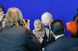 A bodyguard holds an undentified female journalist (C) as she shouts abuse at Egypt's President Abdel Fattah al-Sisi during a joint news conference with German Chancellor Angela Merkel at the Chancellery in Berlin, Germany June 3, 2015.         REUTERS/Fabrizio Bensch TPX IMAGES OF THE DAY