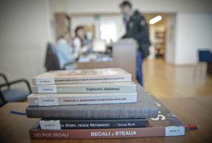 In this photo taken on Thursday, Jan. 14, 2016,  books written by inmates and published while serving jail time are placed on a table at the National Library in Bucharest, Romania. Romania's crackdown on corruption and fraud in recent years has created a sudden and unexpected literary boom, as prisoners publish hundreds of non-fiction books on subjects as varied as soccer, real estate, God and gemstones. (AP Photo)