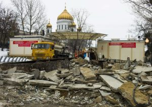 Ruins of flattened kiosks seen with the Christ the Saviour Cathedral at the background in downtown Moscow, Wednesday, Feb. 10, 2016. About half of Moscow's 104 kiosks, which sell items ranging from pastries and flowers to trinkets and kebabs, were flattened Monday evening. The city decided to tear them down in December, and the remaining ones will be torn down by Feb. 24, according to the Russian RIA Novosti news agency. It's unclear what will be put in their place. (AP Photo/Alexander Zemlianichenko)