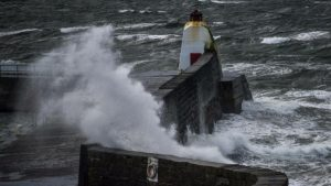 399029-waves-lash-against-the-pier-in-burghead-moray-on-february-01-2016-storm-henry
