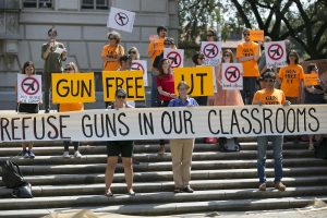Protestors gathered on the West Mall of the University of Texas campus to oppose a new state law that expands the rights of concealed handgun license holders to carry their weapons on public college campuses and as of August 1, 2016, they can carry in campus buildings. Schools can however designate limited gun-free zones.  (Ralph Barrera/Austin American-Statesman via AP)