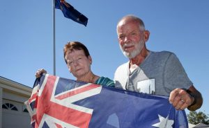 Bill and Val Ashman with the Australian flag and their flag pole at their Icelandic Meandor home in Baldivis. A neighbour has complained citing lack of council approval and they are now liable to a retrospective approval fee.    Picture: Bill Hatto   The West Australian