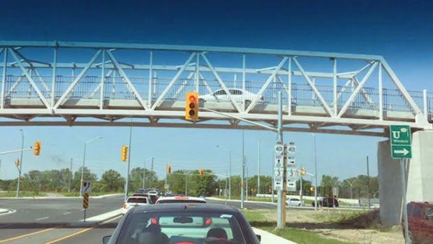 herb-gray-pedestrian-bridge-car