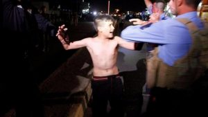 469443-iraqi-security-fores-detain-the-boy