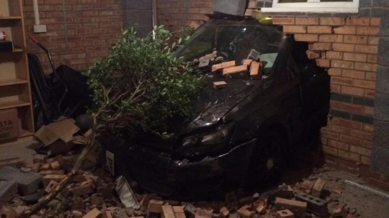 487278-the-car-crashed-into-a-garage