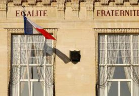 Official  building with french flag and egalite fraternite words