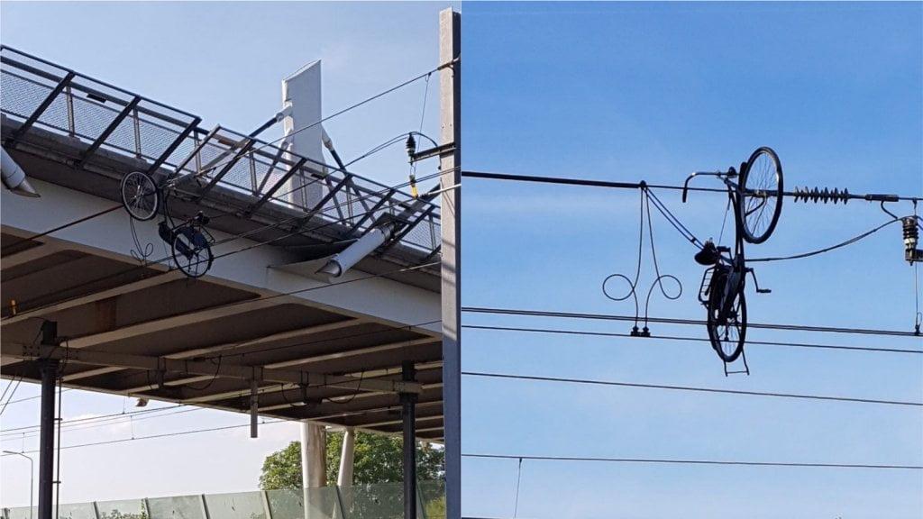 荷蘭佬超癲 將單車拋上架空電纜 成個區鐵路停駛
